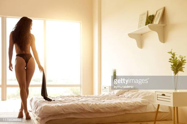sexy woman in bedroom - sensuality stock pictures, royalty-free photos & images