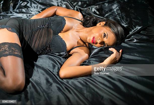 sexy woman in bedroom - black women in stockings stock photos and pictures