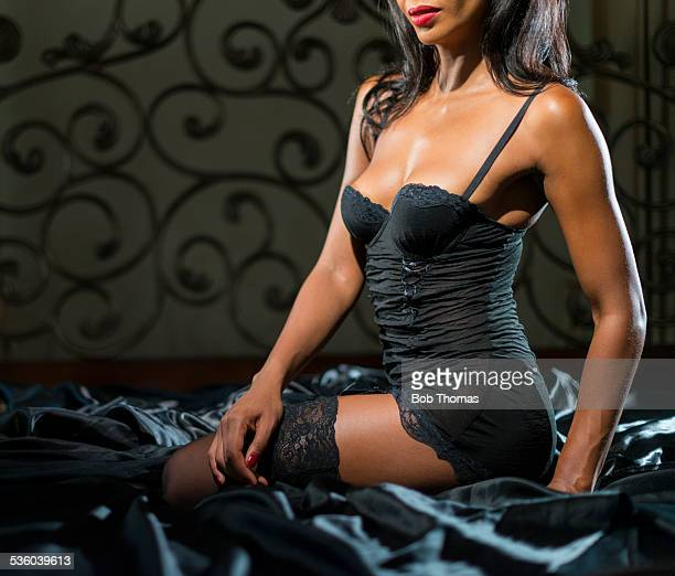 sexy woman in bedroom - women in black stockings stock photos and pictures