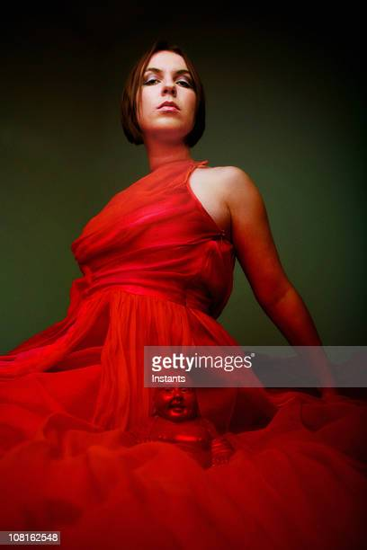 Sexy woman in red dress with buddha: Vector Queen