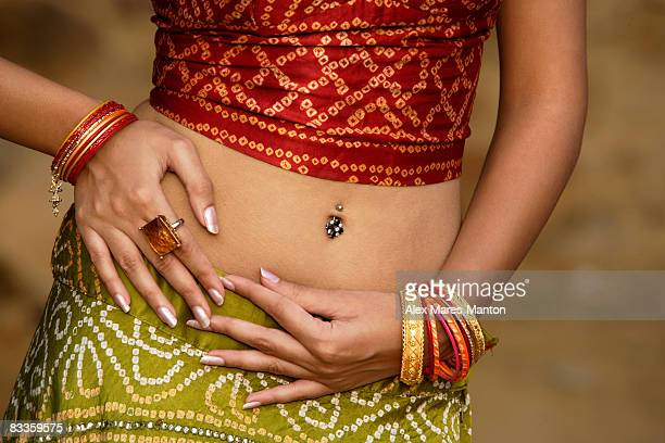 sexy woman in sari, belly piercing - belly ring stock photos and pictures