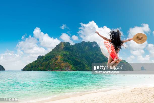 sexy woman jump - french polynesia stock pictures, royalty-free photos & images