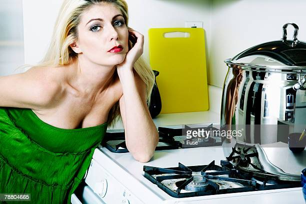 Sexy Woman Leaning on Stove
