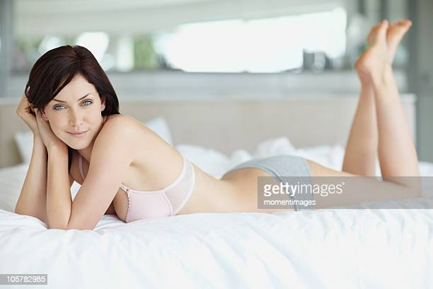 Sexy woman lying on bed
