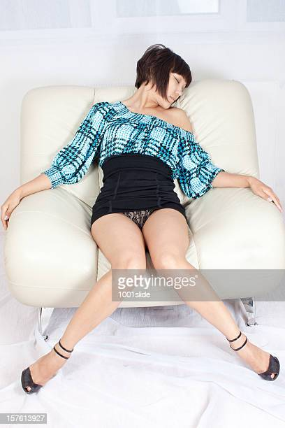 sexy woman: mini black skirt - legs and short skirt sitting down stock pictures, royalty-free photos & images