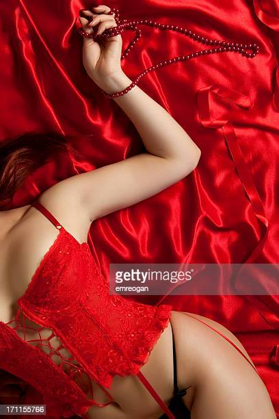 sexy woman on red satin - red belt stock photos and pictures