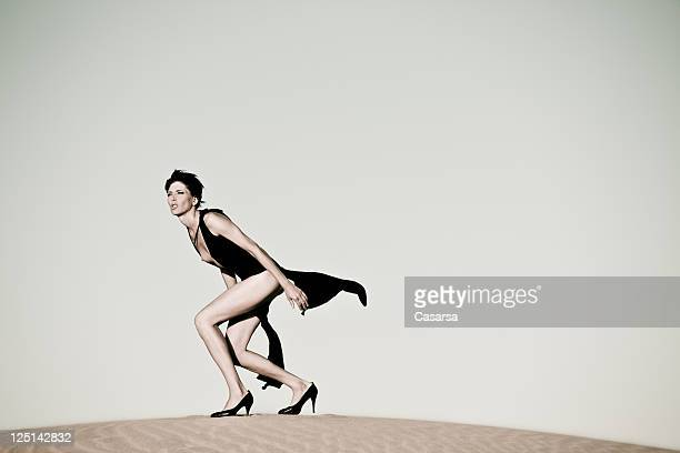 Sexy woman on sand dune