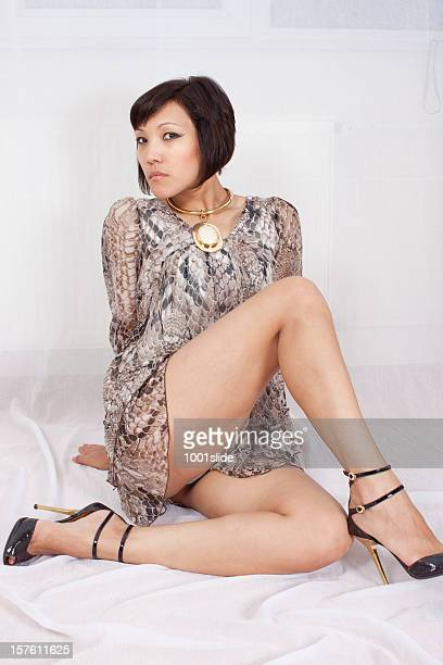 sexy woman - legs and short skirt sitting down stock pictures, royalty-free photos & images