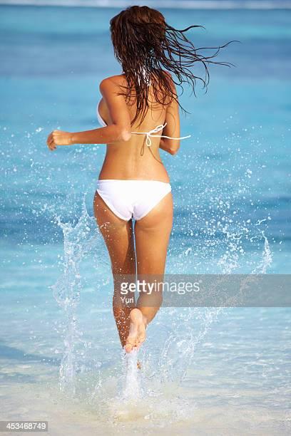 Sexy woman running in bikini