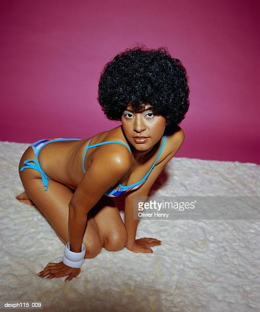 sexy woman wearing bikini, high angle view - african american 70s fashion stock photos and pictures