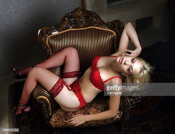 sexy woman with red lingerie - suspenders stock pictures, royalty-free photos & images