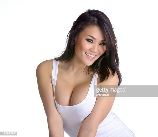 sexy young asian woman in white tank top - beautiful cleavage stock photos and pictures
