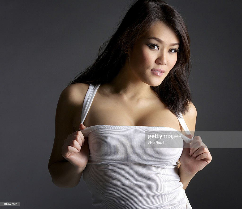 Sexy Young Asian Woman in White Tank Top : Stock Photo