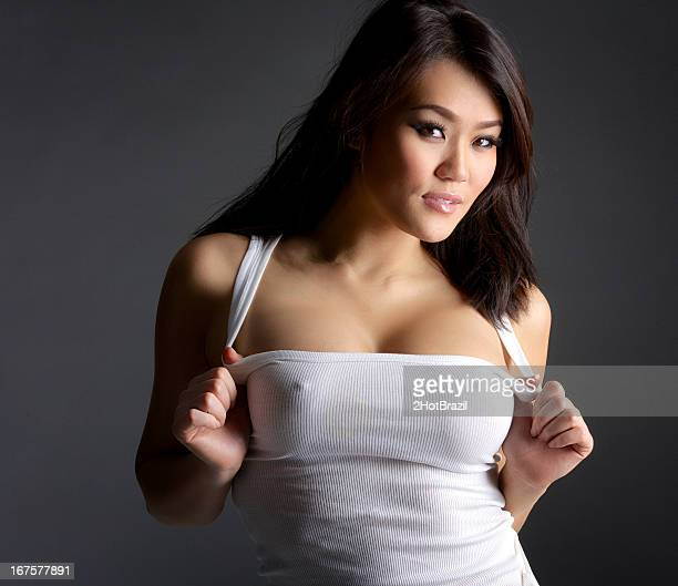 sexy young asian woman in white tank top - erotische stockfoto's en -beelden