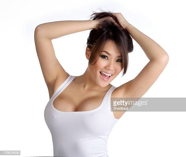 sexy young asian woman in white tank top - hot babe stockfoto's en -beelden