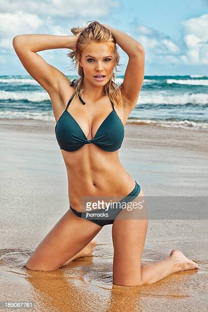 sexy young blonde woman in dark green bikini - buxom blonde stock photos and pictures