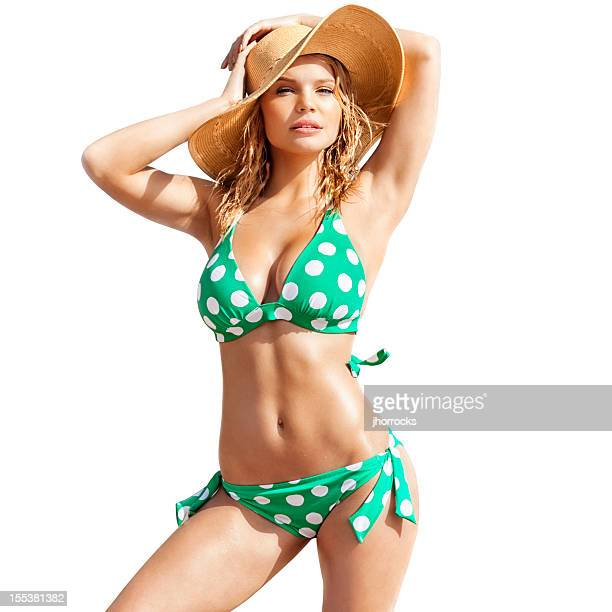 Sexy Young Blonde Woman in Green Polka-dot  Bikini