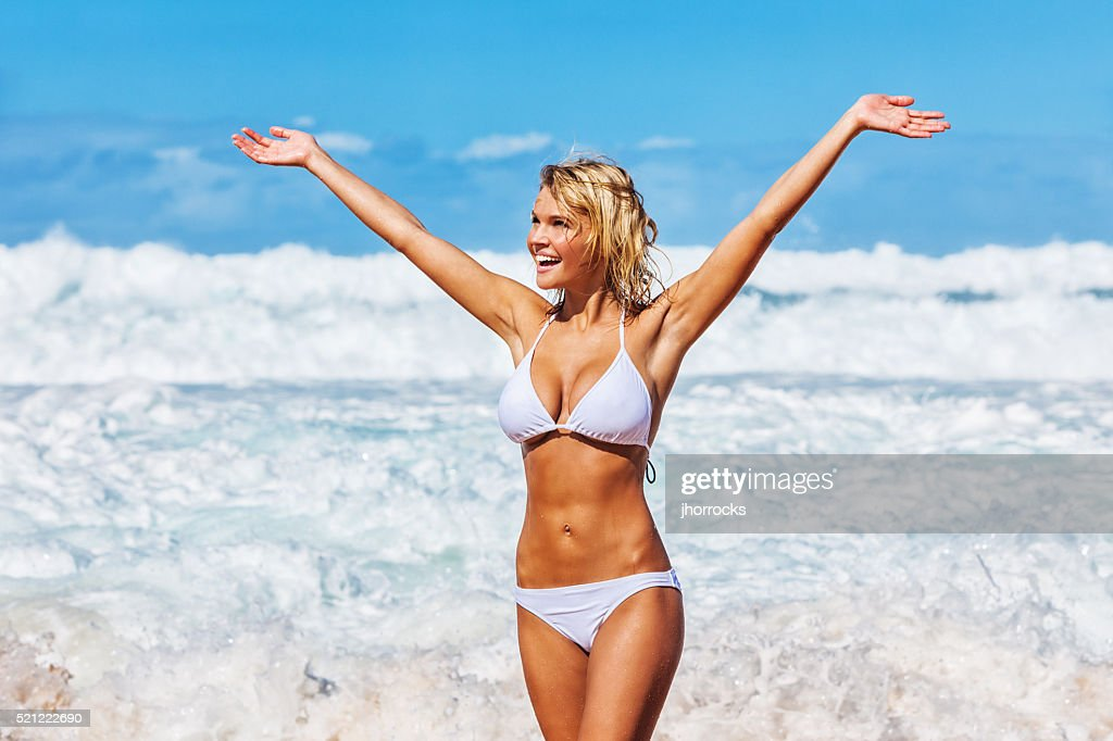 Sexy Young Carefree Woman on Hawaiian Beach wearing White Bikini : Stock Photo