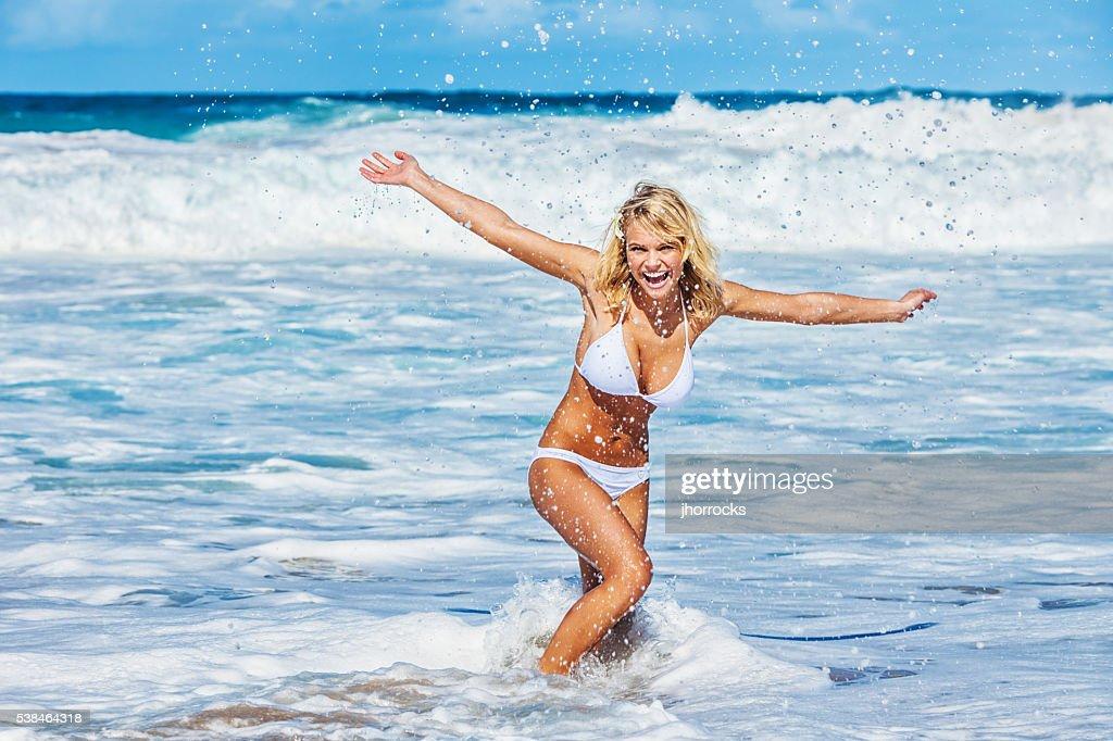 Sexy Young Carefree Woman on Hawaiian Beach wearing White Bikini : Stock Photo