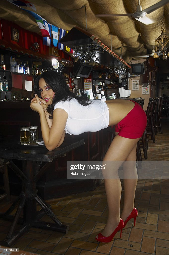 Sexy Young Waitress Wearing Hot Pants Leaning On Table Stock Photo
