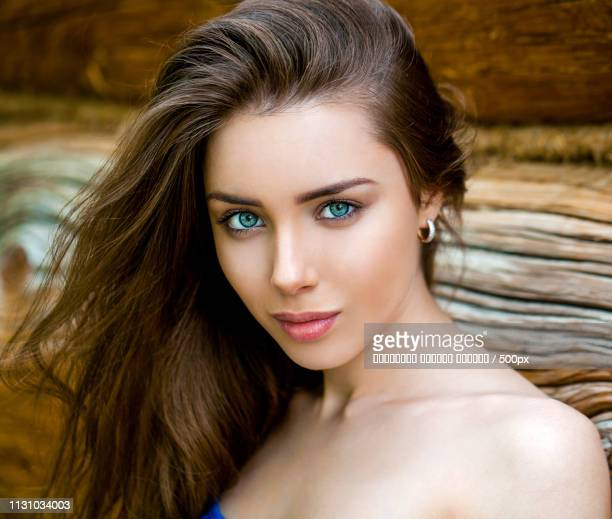 Sexy Young Woman, Against The Background Of The Old Wooden Board