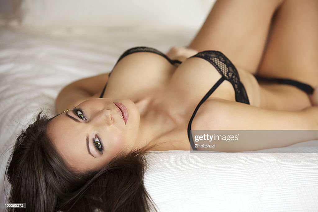 Sexy Young Woman in Lingerie on a Bed : Stock Photo