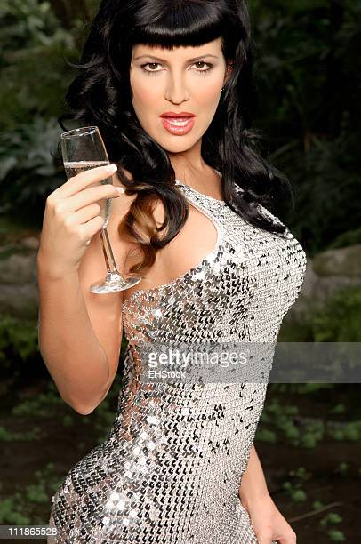 Sexy Young Woman in Sequined Gown Sips Champagne