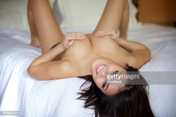 sexy young woman nude on a bed - naket bildbanksfoton och bilder
