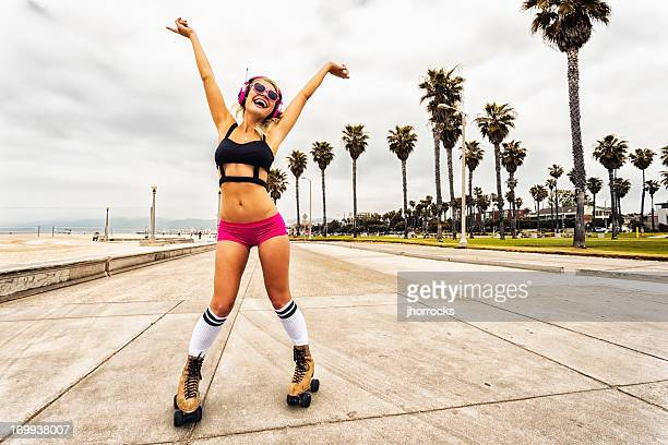 sexy young woman roller skating - roller skating stock photos and pictures