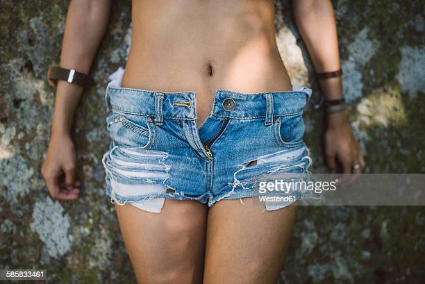 sexy young woman wearing hot pants, close-up - hot pants stock photos and pictures