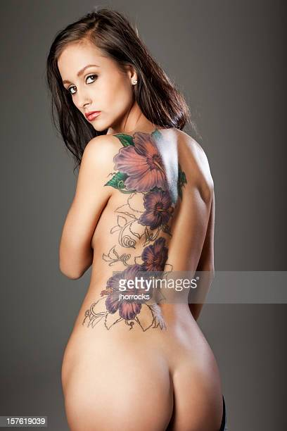 sexy young woman with tattoo - bare bottom women stock photos and pictures