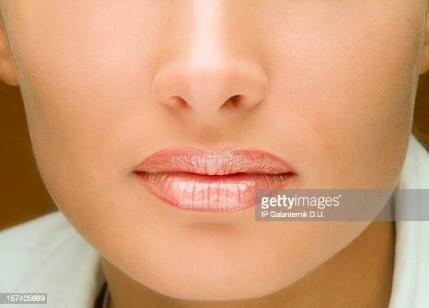 Sexy young woman's lips. Shiny pink lipstick. Lipgloss.