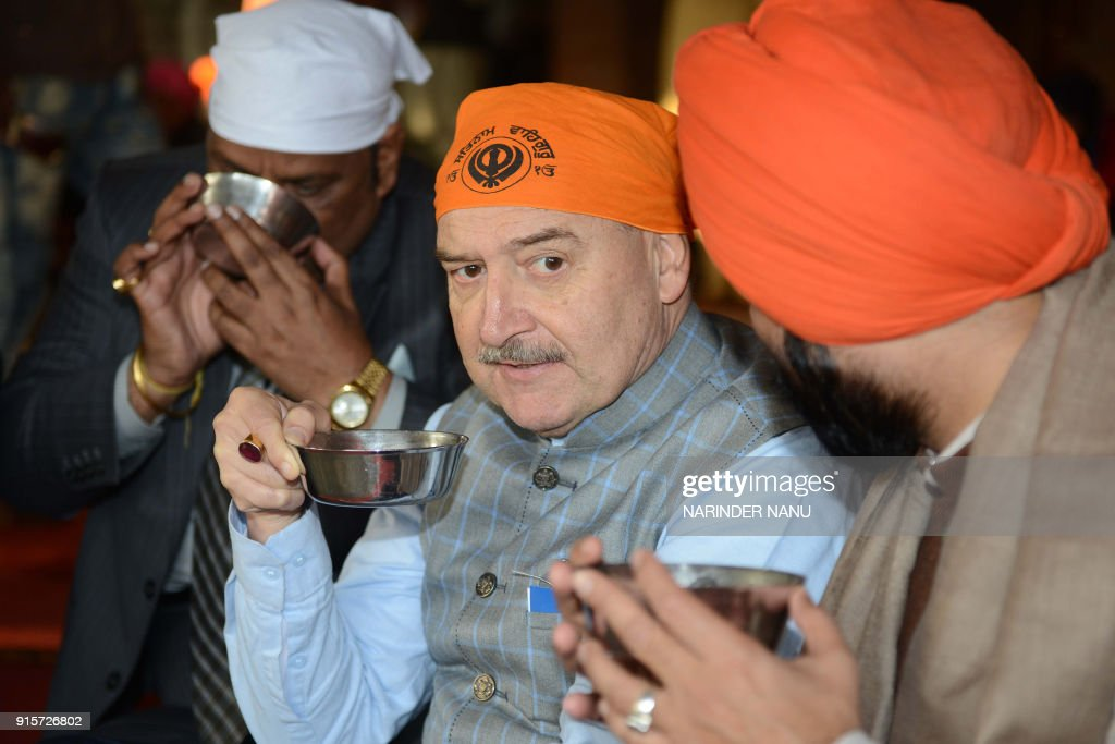 Seychelles Ambassador Philippe Le Gall drinks tea during his visit to the Golden Temple in Amritsar on February 8 2018 / AFP PHOTO / NARINDER NANU