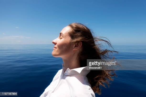 seychelles, indian ocean, profile of woman on ferry enjoying breeze - hot women on boats stock pictures, royalty-free photos & images