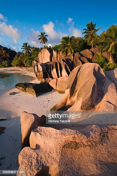 seychelles, la digue island, anse source d'argent beach, dusk - la digue island stock pictures, royalty-free photos & images