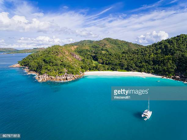 seychelles, praslin, anse georgette, catamaran, aerial view - seychelles stock pictures, royalty-free photos & images