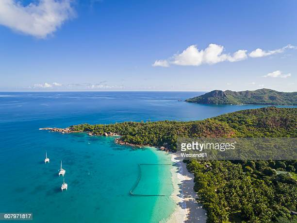 Seychelles, Praslin, Anse Lazio, beach and fishing net, Curieuse Island in the background, aerial view