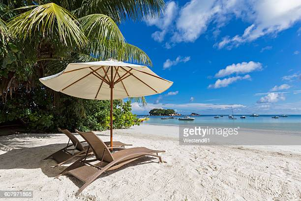 Seychelles, Praslin, Anse Volbert, Chauve Souris Island and Saint Pierre, beach with sun loungers