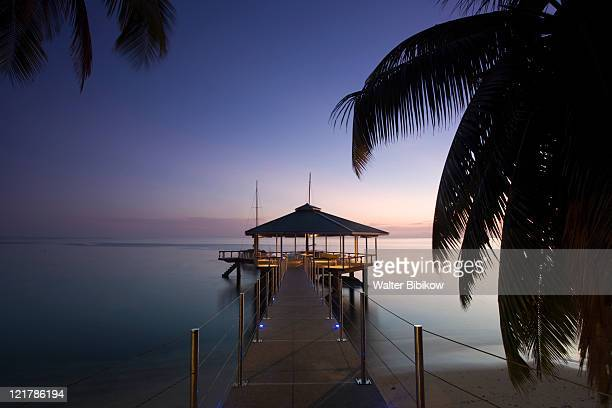 Seychelles, Praslin Island, Anse Bois de Rose, Pier at the Coco de Mer hotel at sunset