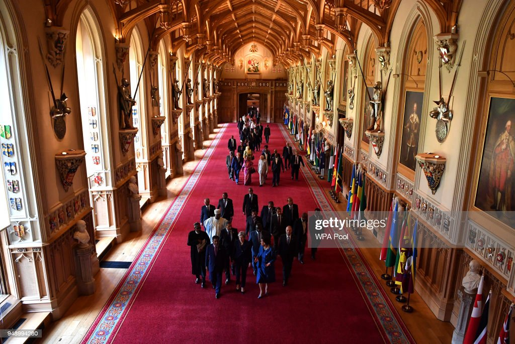 Seychelles' President Danny Faure, Britain's Prime Minister Theresa May and Commonwealth Secretary General Patricia Scotland lead other leaders down St George's hall during a Commonwealth Heads of Government meeting (CHOGM) retreat at Windsor Castle on April 20, 2018 in Windsor, England. The UK is hosting the heads of state and government from the Commonwealth nations this week.