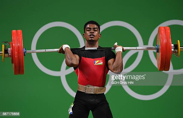 Seychelles' Rick Yves Confiance competes during the men's 62kg weightlifting event at the Rio 2016 Olympic games in Rio de Janeiro on August 8 2016 /...