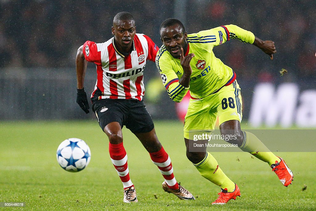 Seydou Doumbia of CSKA gets past the trackle from Nicolas Isimat-Mirin of PSV during the group B UEFA Champions League match between PSV Eindhoven and CSKA Moscow held at Philips Stadium, on December 8, 2015 in Eindhoven, Netherlands.