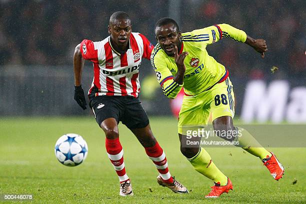 Seydou Doumbia of CSKA gets past the trackle from Nicolas IsimatMirin of PSV during the group B UEFA Champions League match between PSV Eindhoven and...
