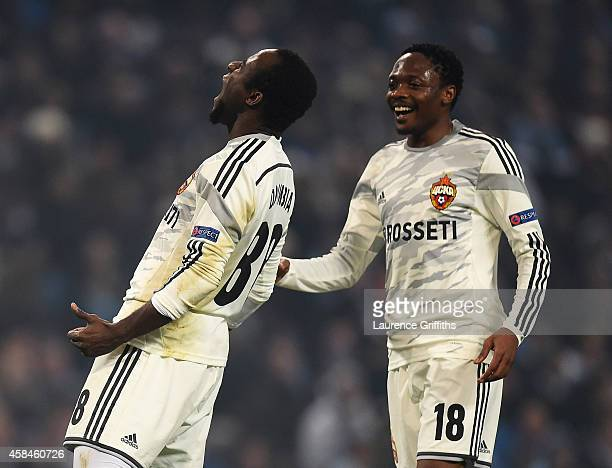 Seydou Doumbia of CSKA Moscow celebrates scoring his team's second goal with Ahmed Musa during the UEFA Champions League Group E match between...