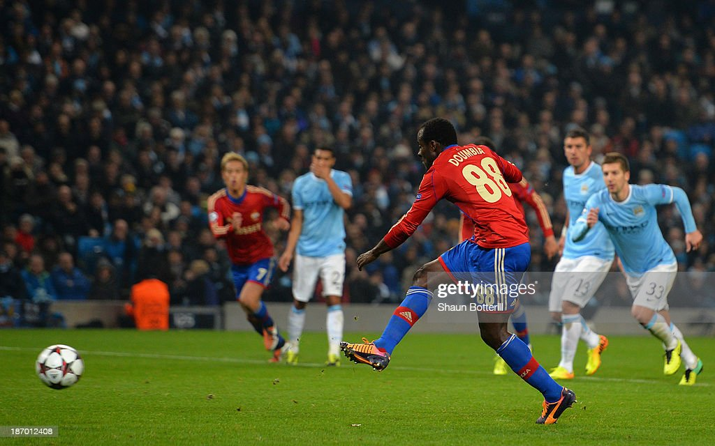 Seydou Doumbia of CSKA scores his team's second goal from a penalty during the UEFA Champions League Group D match between Manchester City and CSKA Moscow at the Etihad Stadium on November 5, 2013 in Manchester, England.