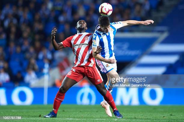 Seydou Doumbia of Girona FC competes for the ball with Aritz Elustondo of Real Sociedad during the La Liga match between Real Sociedad and Girona FC...