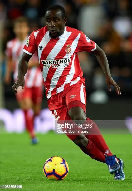 Seydou Doumbia of Girona runs with the ball during the La Liga match between Valencia CF and Girona FC at Estadio Mestalla on November 3 2018 in...