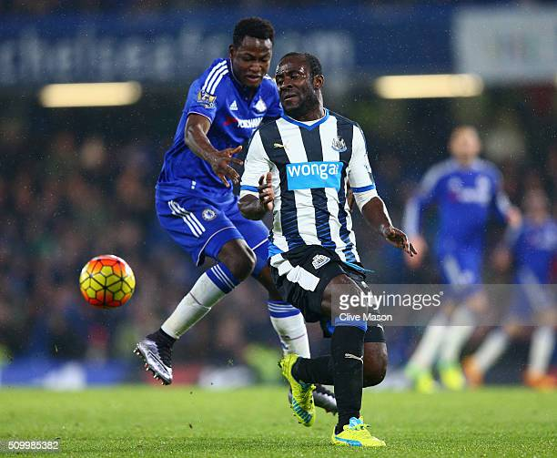 Seydou Doumbia of Newcastle United and Baba Rahman of Chelsea compete for the ball during the Barclays Premier League match between Chelsea and...