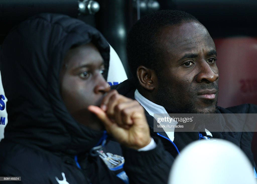 Seydou Doumbia (R), of Newcastle United on the bench during the Barclays Premier League match between Newcastle United FC and West Bromwich Albion FC at St James' Park on February 6, 2016 in Newcastle Upon Tyne, England.
