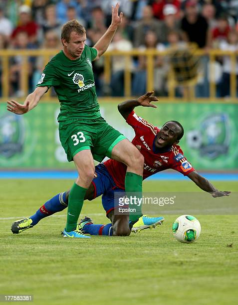 Seydou Doumbia of PFC CSKA Moscow in action against Vladimir Rykov of FC Tom Tomsk during the Russian Premier League match between FC Tom Tomsk and...